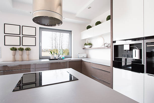 Up-to-date decor of kitchen with hob on island
